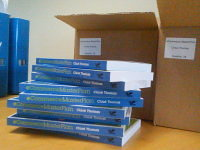 A pile of the first edition of the eCommerce MasterPlan, just waiting to be sent out